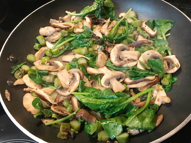 Gently sauté your filling in butter: agaricus white mushrooms, shiitake mushrooms, asparagus, spinach, salt, lemon pepper